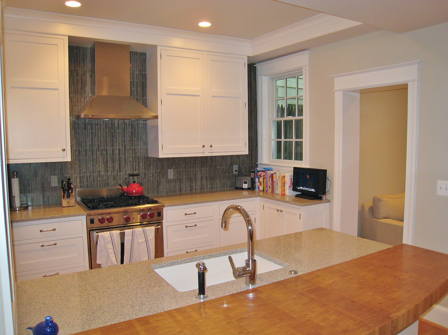 integrated kitchens kitchen transitional slate backsplash the kitchen now reflects the warm and inviting qualities of the homeowners added bonus the more abundant amount of counter space was all designed